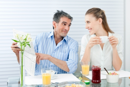 Happy mature couple having healthy breakfast  photo