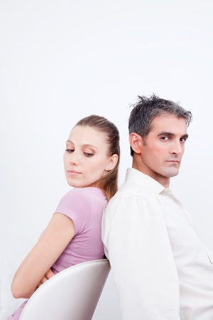 eachother: Couple with their backs turned towards eachother