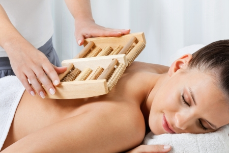 Relaxed young female receiving back massage by a female masseuse at health spa Stock Photo - 14959062
