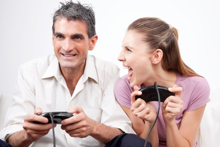 Excited couple playing computer games   photo