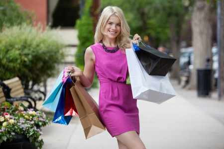 sidewalk sale: Shopping woman on street outdoors with shopping bags