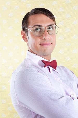 Portrait of thoughtful nerd styled  man on wallpaper Stock Photo - 15101127