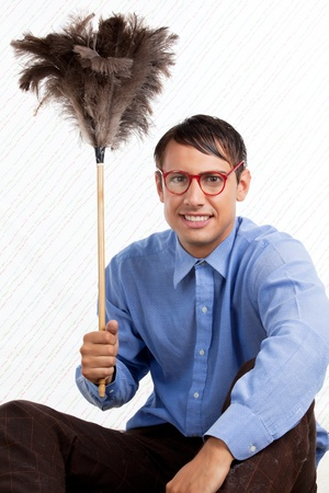 Portrait of retro male holding feather duster photo