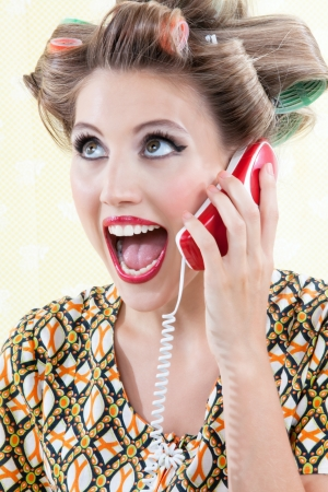 Portrait of funny surprised woman using telephone  photo