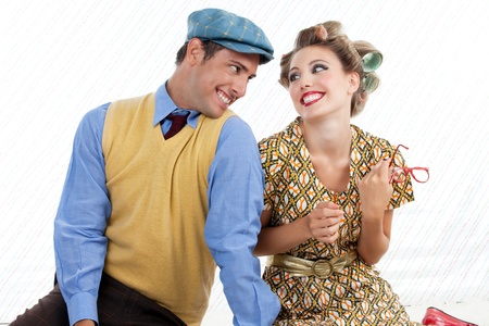 eachother: Portrait of retro young couple looking and smiling at eachother