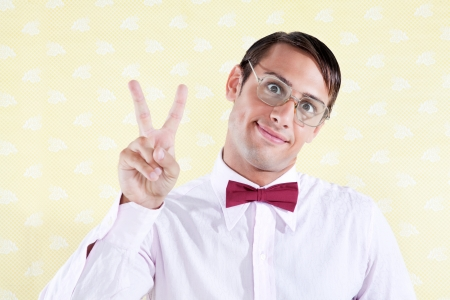 Portrait of a geek styled man giving peace sign Stock Photo - 15347743
