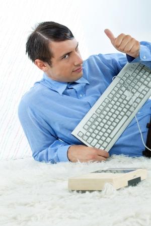 thumb keys: Retro man with keyboard giving thumbs up