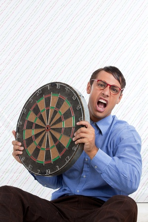 targeted: Retro Styled Man holding a dartboard  Stock Photo