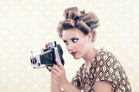 viewfinder vintage: Woman holing vintage 4x6 film camera looking through viewfinder  Stock Photo