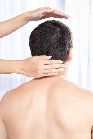 therapeutic: Hand massaging man s head, indoors