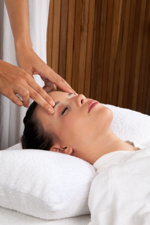 therapeutic: Woman receiving a head massage in spa  Stock Photo
