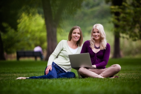 Young Women Using laptop in park  photo