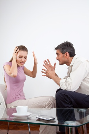 quarrel: Portrait of an angry couple arguing  Stock Photo