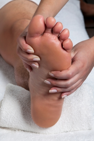 Man receiving a foot massage in spa  photo