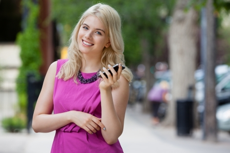 Portrait of an attractive young woman talking on mobile phone photo