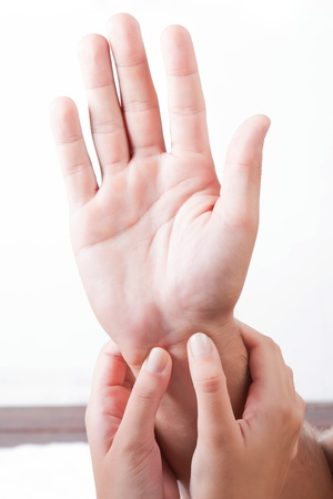 sensual massage: One hand massaged other, indoors