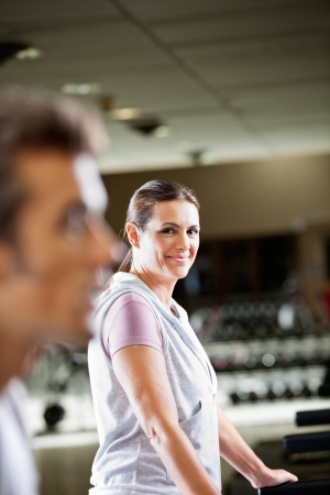Portrait of mature woman working out at health club photo