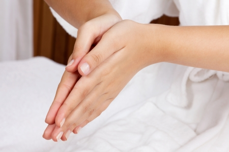 clasped: Cropped image of a woman with hands clasped Stock Photo