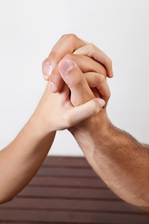clasped: Close up of woman s hand giving a palm acupressure treatment to man