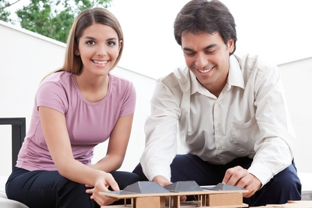 functionalism: Two architects building a rough house study model   Stock Photo