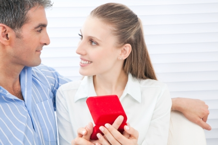 Couple holding box ring in hand  photo