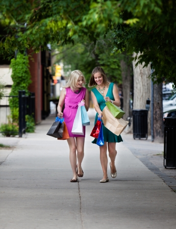 Women looking at Shopping Bags on street  Stock Photo - 15450046