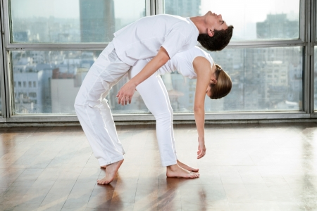 Young man and woman doing stretching fitness exercise at gym Stock Photo - 15483190