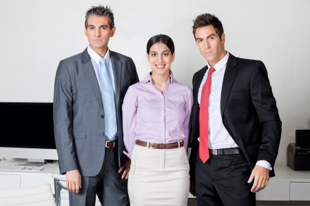 Portrait of three confident businesspeople standing together at office Stock Photo - 16056567