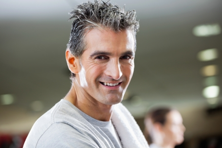 Closeup of portrait of mature man smiling at health club photo