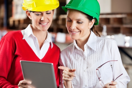Two female supervisors using digital tablet in warehouse Stock Photo - 16085797