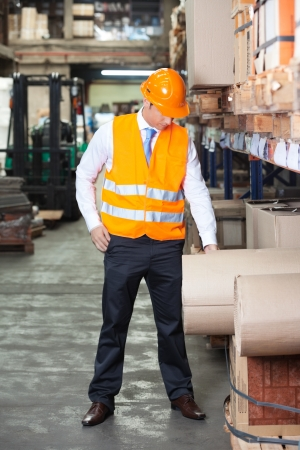 Young supervisor standing at warehouse photo