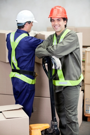 Portrait of foreman with colleague working at warehouse photo
