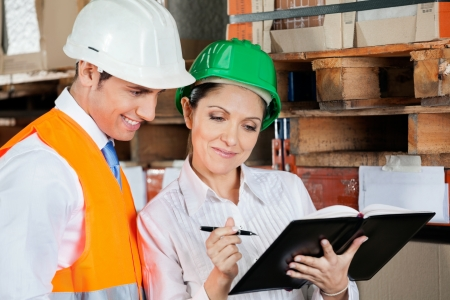 Young female supervisor and colleague working at warehouse Stock Photo - 16155770