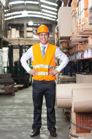 Portrait of confident young supervisor standing at warehouse Stock Photo - 16155419