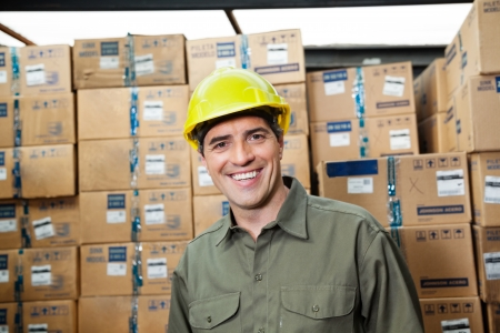 Portrait of happy mid adult foreman at warehouse photo