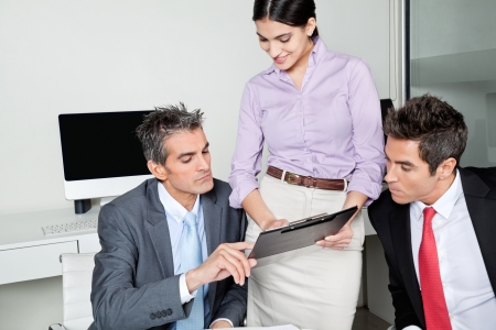 Three businesspeople in meeting at office Stock Photo - 16191687