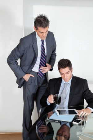 Businessman with digital tablet in a meeting with colleague at office Stock Photo - 16191657