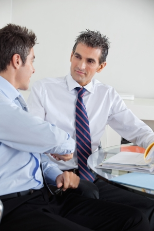 Two businessmen shaking hands at a meeting in office Stock Photo - 16191655
