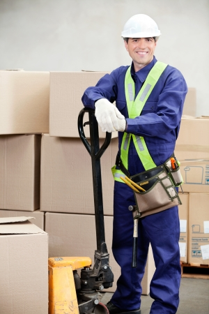 Portrait of confident warehouse worker standing in workplace photo