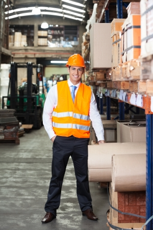 Portrait of confident young supervisor standing at warehouse Stock Photo - 16191656