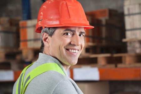 Portrait of confident mid adult foreman at warehouse photo