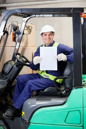 displaying: Forklift Driver Displaying Blank Placard Stock Photo