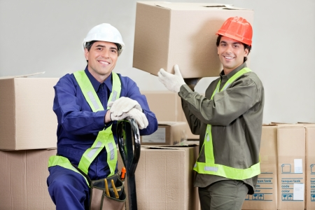 Foremen Loading Cardboard Boxes At Warehouse photo