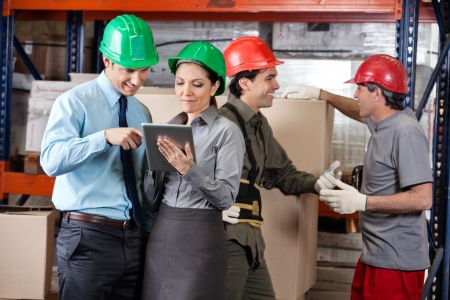 Supervisors And Foremen At Warehouse Stock Photo - 16410377