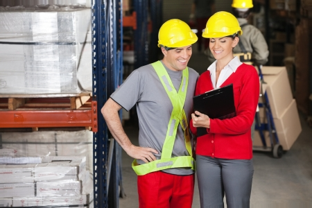 Happy Supervisor Showing Clipboard To Foreman Stock Photo - 16410398