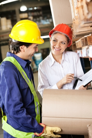 Supervisor Showing Clipboard To Foreman Stock Photo - 16410401