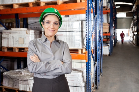 Female Supervisor Wearing Protective Eyeglasses At Warehouse photo