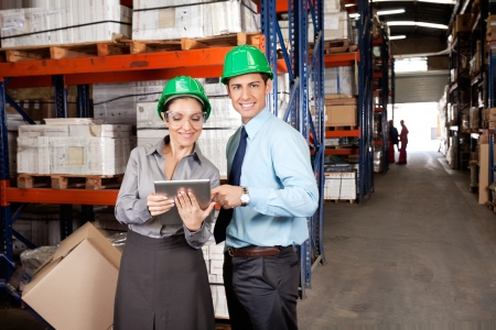 Male Supervisor Using Digital Tablet With Colleague Stock Photo - 16410399