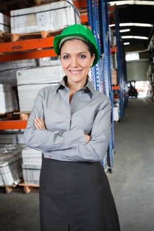 Confident female Supervisor At Warehouse photo