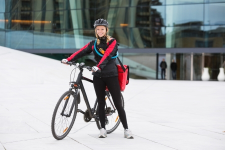 Female Cyclist With Courier Delivery Bag photo